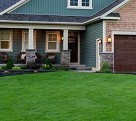 Residential front yard after sod installation