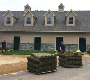 Pallets of sod outside residential home